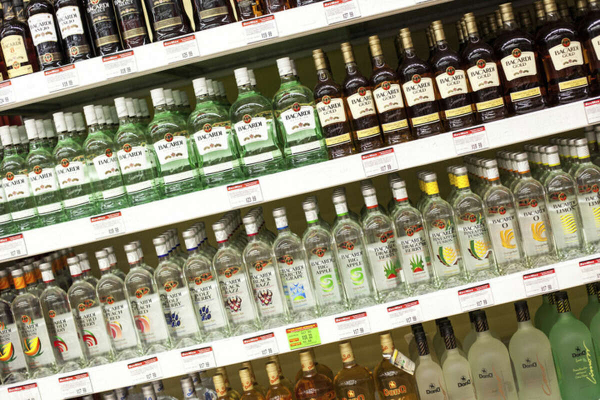 Hour photo/Chris Palermo. Liquor sits on display at Bev Max in Norwalk Sunday afternoon. Gov. Dannel Malloy recently proposed to further loosen Connecticut's alcohol sales laws.