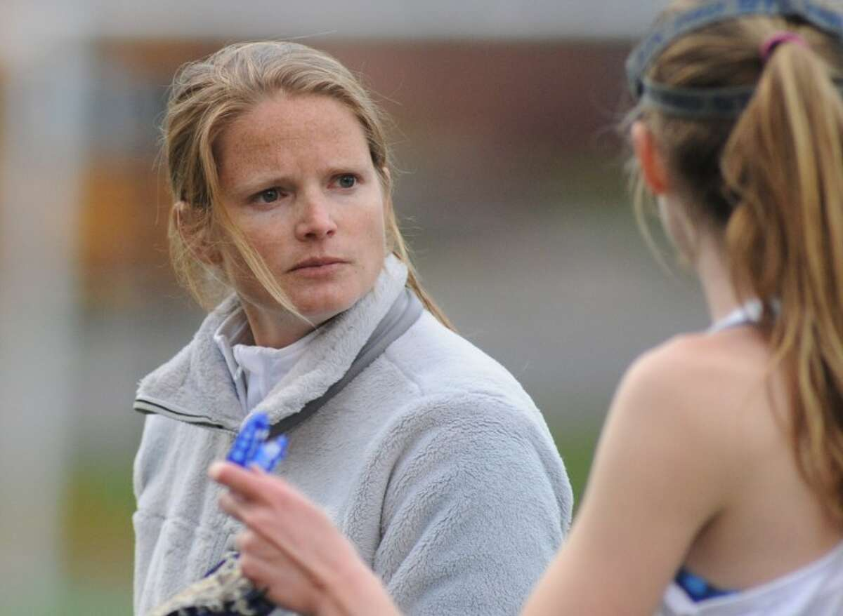 Weston head coach Megan Murphy talks with a team member during a timeout.