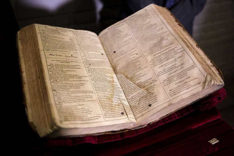 The First Folio of Shakespeare plays recently discovered in Saint-Omer in France, is displayed after a press conference at Shakespeare's Globe theatre in London, Monday, Feb. 23, 2015. The edition, which will be exhibited at the Globe in 2016 the year of the 400th anniversary of Shakespeares' death, is one of 230 copies of the 1623 Shakespeare First Folio and is notable for its scribbled stage directions. (AP Photo/Matt Dunham)