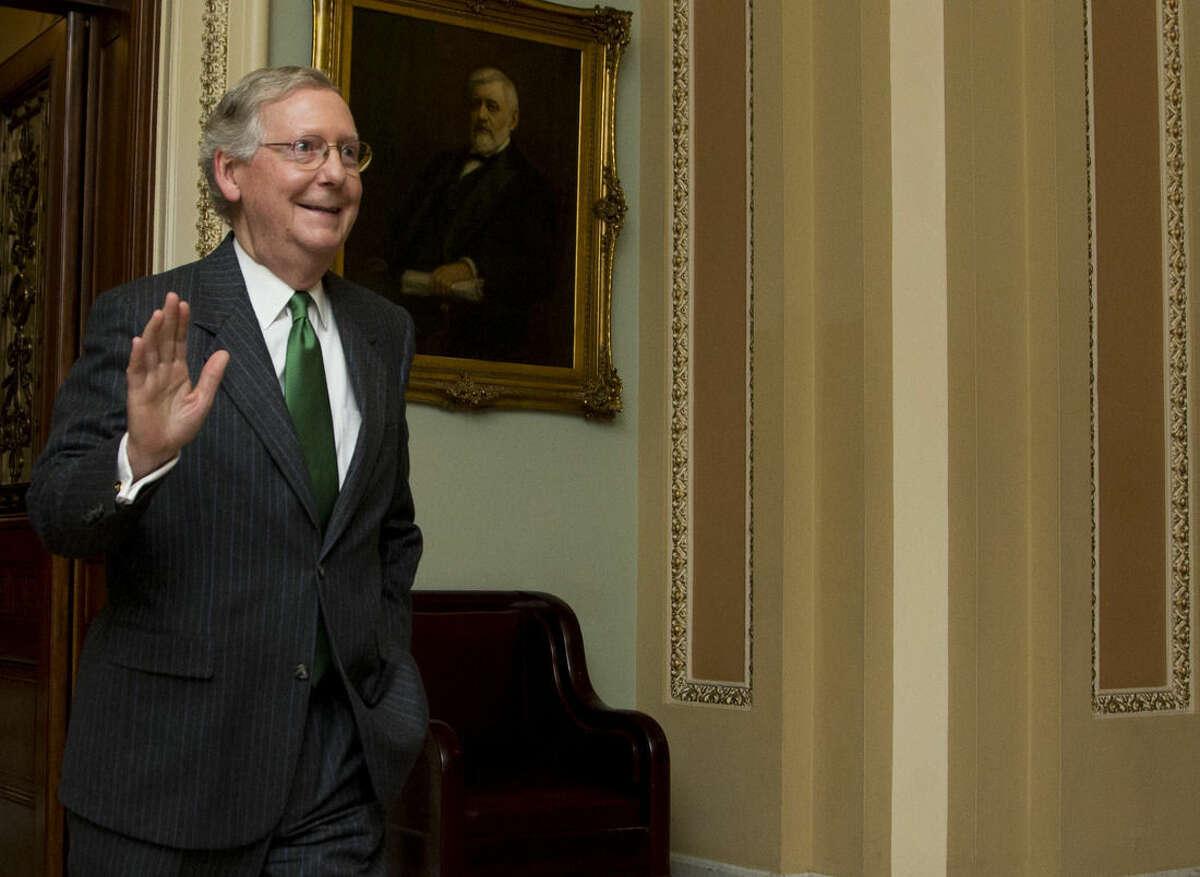 Senate Majority Leader Mitch McConnell, R-Ky., leaves the Senate floor on Capitol Hill in Washington, Monday, Feb. 23, 2015, following a cloture vote. (AP Photo/Manuel Balce Ceneta)