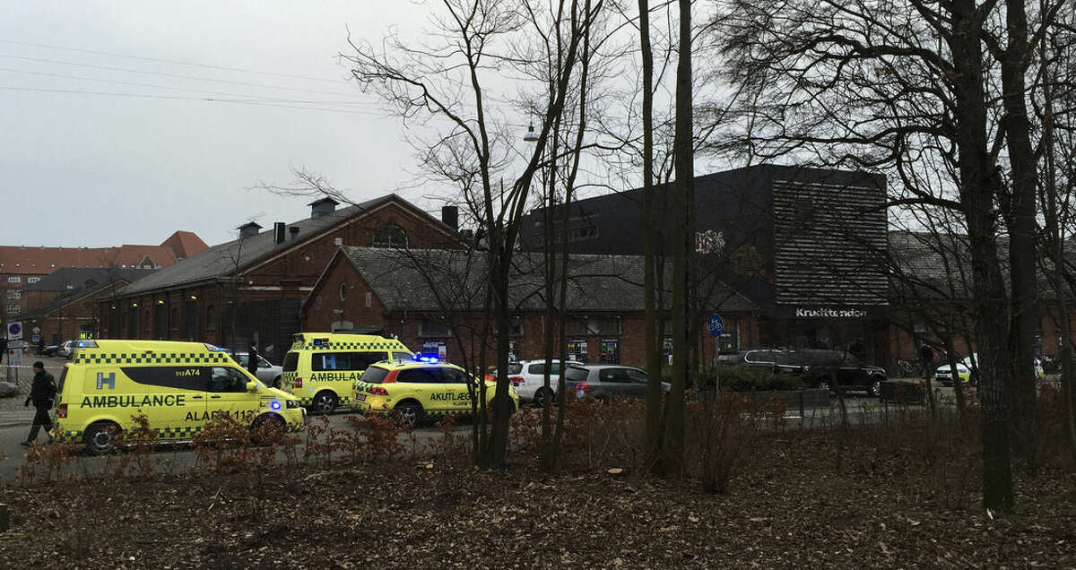 """Emergency services gather outside a venue after shots were fired where an event titled """"Art, blasphemy and the freedom of expression"""" was being held in Copenhagen, Saturday, Feb. 14, 2015. Danish media say several shots have been fired at a cafe in Copenhagen where a meeting about freedom of speech was being held, organized by Swedish artist Lars Vilks, who has faced numerous threats for caricaturing the Prophet Muhammad in 2007. (AP Photo/Polfoto, Mikkel Tariq Khan) DENMARK OUT"""