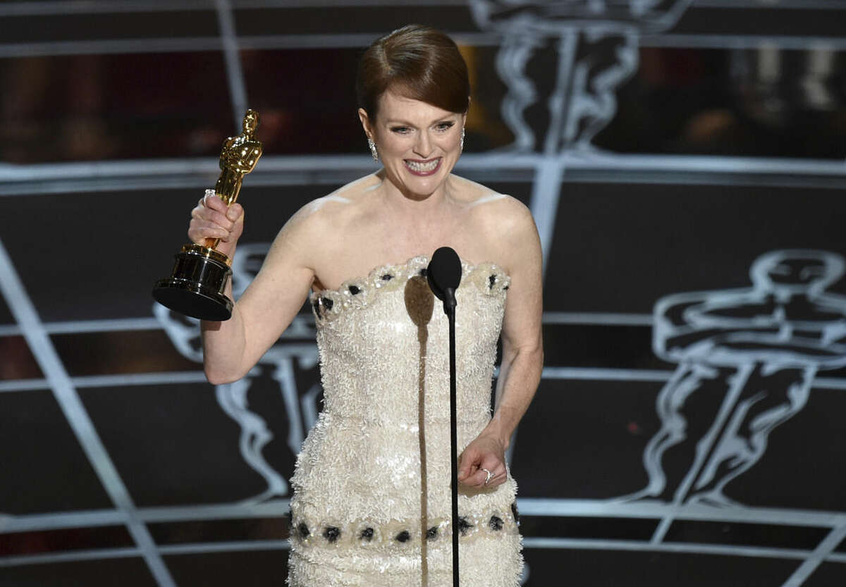 """Julianne Moore accepts the award for best actress in a leading role for """"Still Alice at the Oscars on Sunday, Feb. 22, 2015, at the Dolby Theatre in Los Angeles. (Photo by John Shearer/Invision/AP)"""