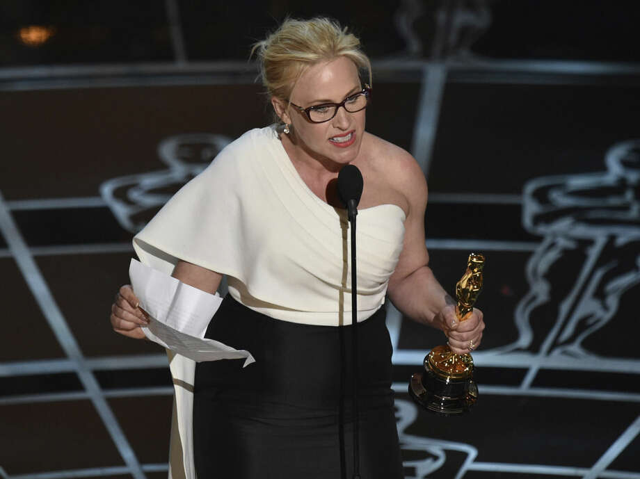 "Patricia Arquette accepts the award for best actress in a supporting role for ""Boyhood"" at the Oscars on Sunday, Feb. 22, 2015, at the Dolby Theatre in Los Angeles. (Photo by John Shearer/Invision/AP)"