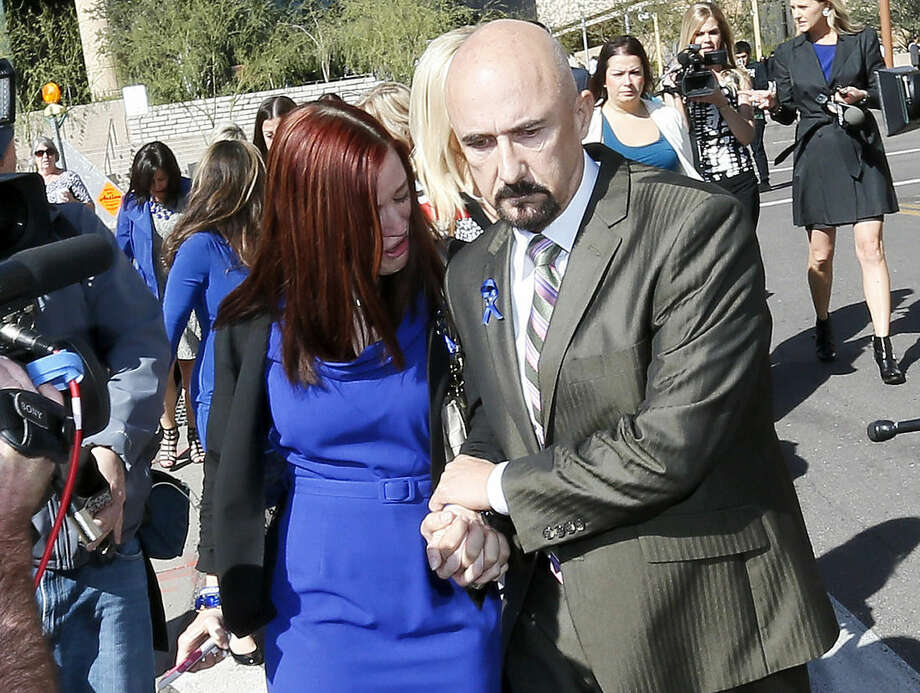 Tanisha Sorenson, sister of murder victim Travis Alexander, leaves the court house with her husband, Harold Sorenson, Thursday, March 5, 2015, in Phoenix. A judge declared a mistrial Thursday in the Jodi Arias sentencing retrial after a jury deadlocked on whether the convicted murderer should be executed or sent to prison for life for the 2008 killing of Alexander. (AP Photo/Matt York)