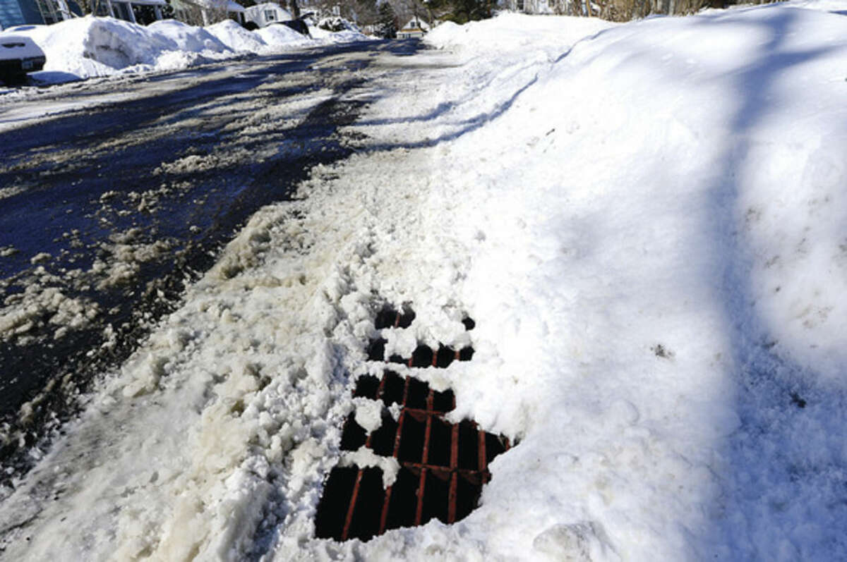 """Hour photo / Erik Trautmann One of the 16,000 catch basins/storm drains in Norwalk along Scofield Avenue. The Mayor's Office is launching a """"Storm Drain Superstar"""" initiative by asking residents to clear the catch basins/storms drains along their property."""
