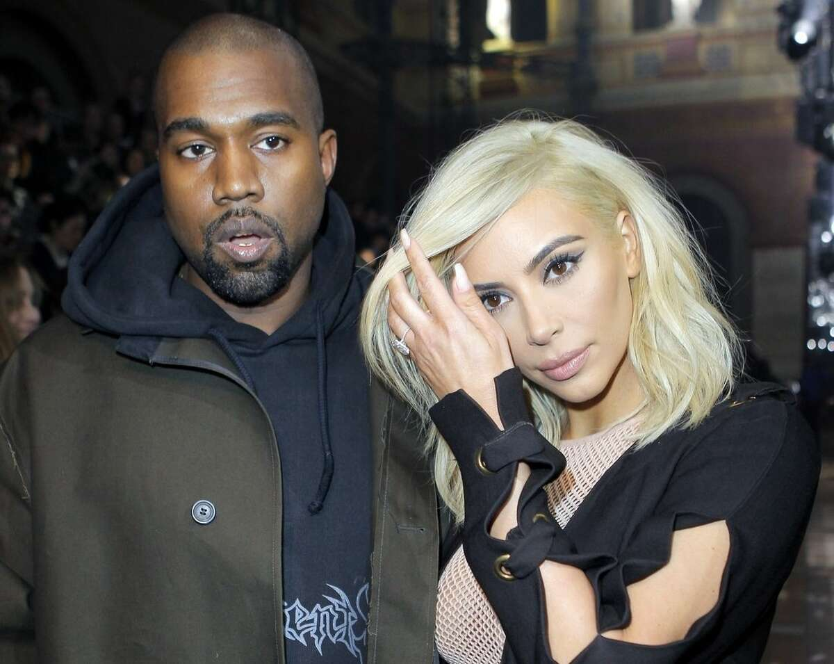 Kanye West and Kim Kardashian arrive for Lanvin's ready-to-wear Fall-Winter 2015/2016 fashion collection, part of the Paris Fashion Week, Thursday March 5, 2015 in Paris, France. (AP Photo/Jacques Brinon)