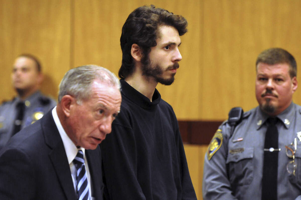 FILE - In this Feb. 25, 2015 file photo, Wesleyan University senior Eric Lonergan, 22, stands during arraignment at Middletown, Conn., Superior Court for possession of controlled substances and other charges. He is one of four students arrested after a rash of illnesses on campus linked to the party drug Molly. (AP Photo/The Hartford Courant, Patrick Raycraft, Pool)