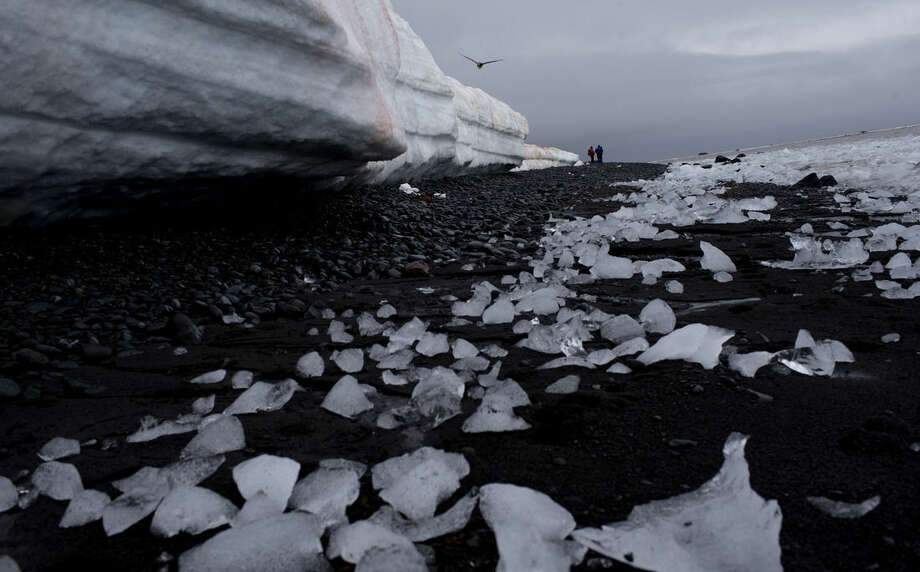 In this Jan. 26, 2015 photo, pieces of thawing ice are scattered along the beachshore at Punta Hanna, Livingston Island, South Shetland Island archipelago, Antarctica. Water is eating away at the Antarctic ice, melting it where it hits the oceans. As the ice sheets slowly thaw, water pours into the sea, 130 billion tons of ice (118 billion metric tons) per year for the past decade, according to NASA satellite calculations. (AP Photo/Natacha Pisarenko)