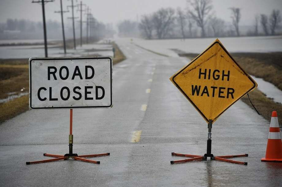 High water closes a stretch of Kentucky 812/Airline Road Wednesday, March 4, 2015. Nearly 2.5 inches of rain has fallen since Tuesday evening, causing some highways in Henderson, Union and Webster counties to be closed because of flooding. (AP Photo/The Gleaner, Mike Lawrence)