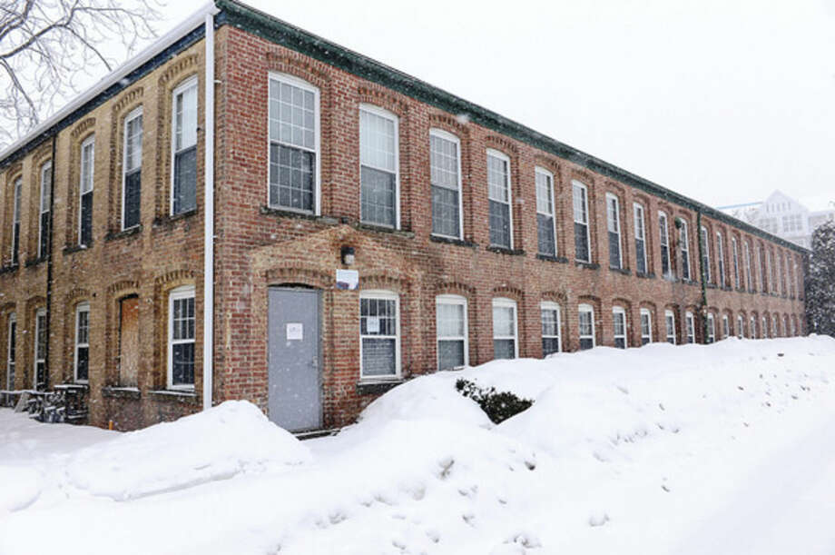 Hour photo / Erik TrautmannThe former hat factory at 3 Quincy Street is being preserved and moved across the street in the midst of Waypointe development
