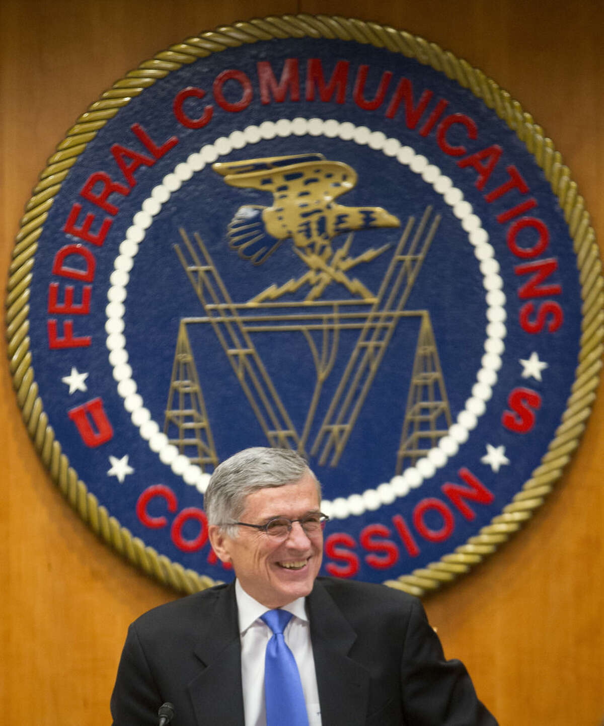 AP photo/ Pablo Martinez Monsivais Federal Communication Commission (FCC Chairman Tom Wheeler takes his seat before the start of an open hearing in Washington, Thursday, Feb. 26.