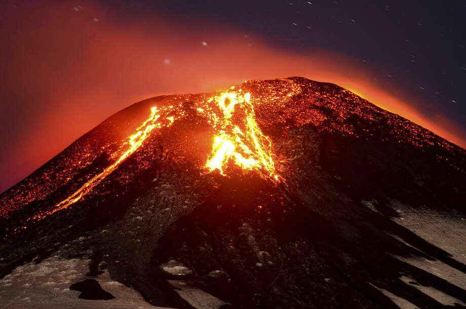 The Villarica volcano erupts near Pucon, Chile, early Tuesday, March 3, 2015. The Villarica volcano erupted Tuesday around 3 a.m. local time (0600 GMT), according to the National Emergency Office, which issued a red alert and ordered evacuations. (AP Photo/ Lautaro Salinas) CHILE OUT - NO USAR EN PUBLICACIONES O WEBSITES EN CHILE