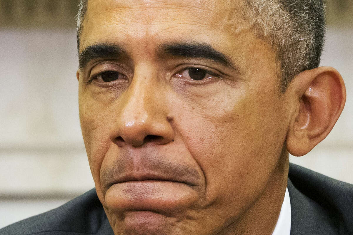 President Barack Obama pauses while speaking about Iran and Israeli Prime Minister Benjamin Netanyahu's speech to Congress, Tuesday, March 3, 2015, during a meeting with Defense Secretary Ash Carter in the Oval Office of the White House in Washington. (AP Photo/Jacquelyn Martin)