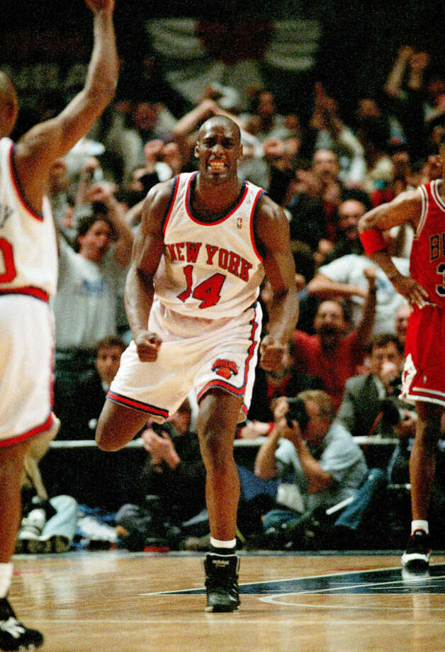 FILE - In this May 8, 1994 file photo, New York Knicks Anthony Mason (14) celebrates as the Knicks pull within one point of the Chicago Bulls during the fourth period of the NBA Eastern Conference Semifinal game in New York. The New York Knicks spokesman Jonathan Supranowitz confirmed Saturday, Feb. 28, 2015 that Mason, a rugged power forward who was a defensive force for several NBA teams in the 1990s, has died. He was 48. (AP Photo/Bill Kostroun)