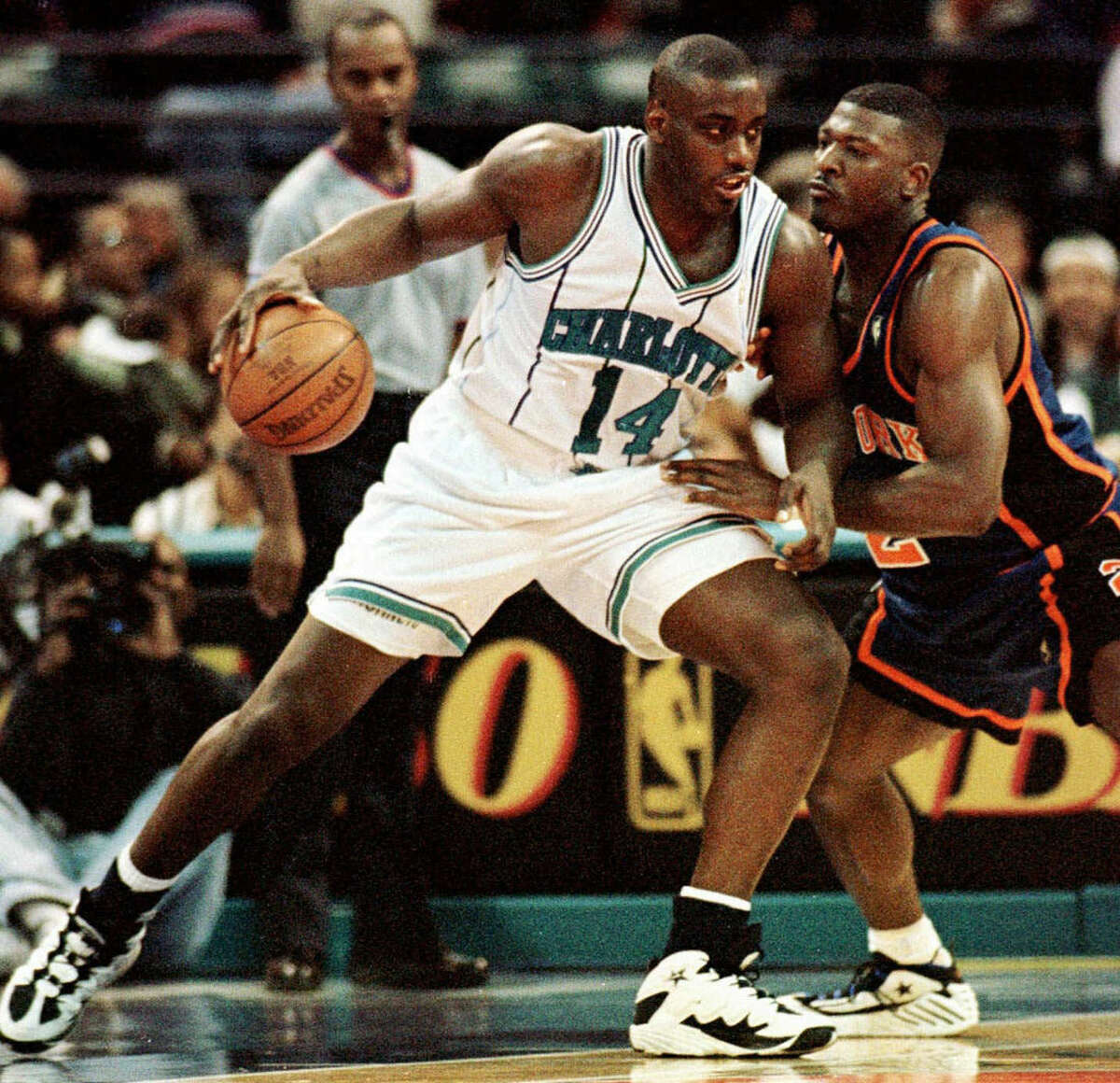 FILE - In this Nov. 20, 1996 file photo, Charlotte Hornets forward Anthony Mason, left, leans in on New York Knicks forward Larry Johnson during first quarter of an NBA basketball game in Charlotte, N.C. The New York Knicks spokesman Jonathan Supranowitz confirmed Saturday, Feb. 28, 2015 that Mason, a rugged power forward who was a defensive force for several NBA teams in the 1990s, has died. He was 48. (AP Photo/Peter A. Harris)