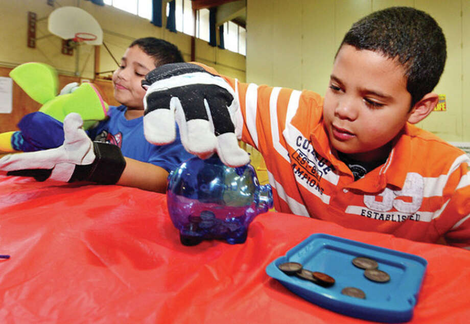 Hour photo / Erik TrautmannCranbury Elementary School fifth graders, including Mike Avila, learn what it is like to live with a handicap Thursday during the Walk In My Shoes program. / (C)2013, The Hour Newspapers, all rights reserved