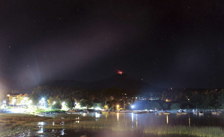 The Villarica volcano erupts near Pucon, Chile, early Tuesday, March 3 , 2015. The Villarica volcano erupted Tuesday around 3 a.m. local time (0600 GMT), according to the National Emergency Office, which issued a red alert and ordered evacuations.(AP Photo/ Gabriela Ulloa) CHILE OUT - NO USAR EN PUBLICACIONES O WEBSITES EN CHILE
