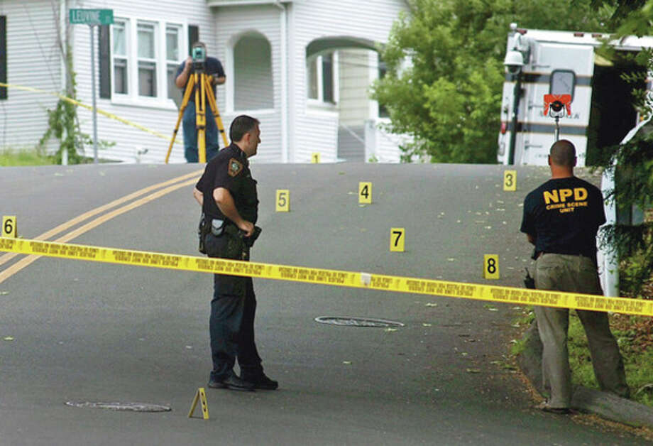 Norwalk police investigate a shooting on Grandview Ave near Jefferson Elementary School Friday afternoon. Both Jefferson and Kendall Elemenatry Schools were pu on lock-down for the duration on the school day.Hour photo / Erik Trautmann / (C)2012, The Hour Newspapers, all rights reserved