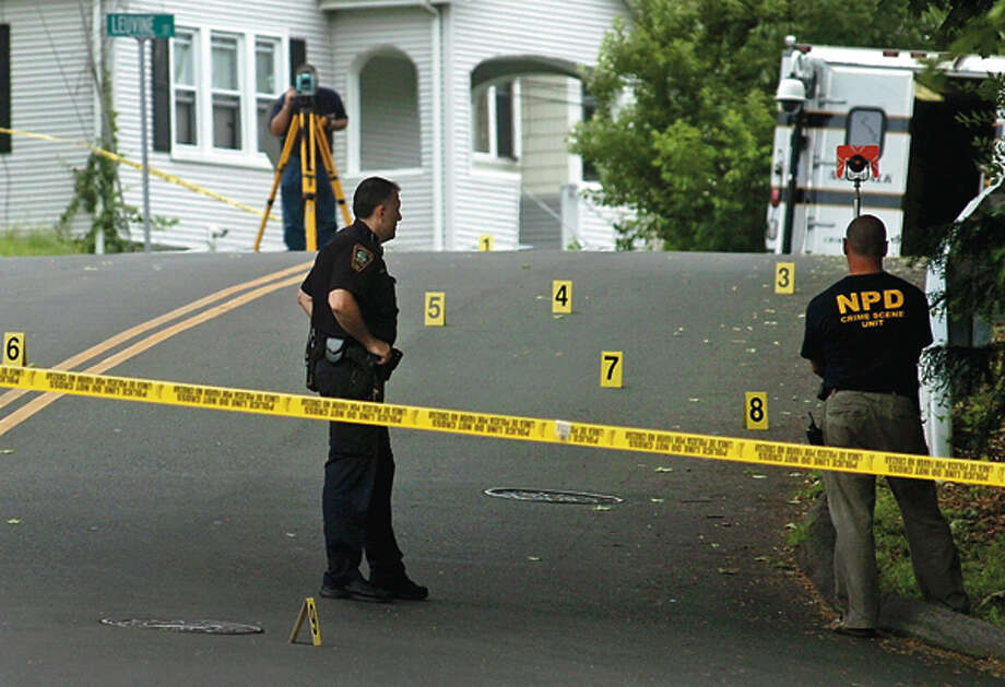 Norwalk police investigate a shooting on Grandview Ave near Jefferson Elementary School Friday afternoon. Both Jefferson and Kendall Elemenatry Schools were pu on lock-down for the duration on the school day. Hour photo / Erik Trautmann / (C)2012, The Hour Newspapers, all rights reserved