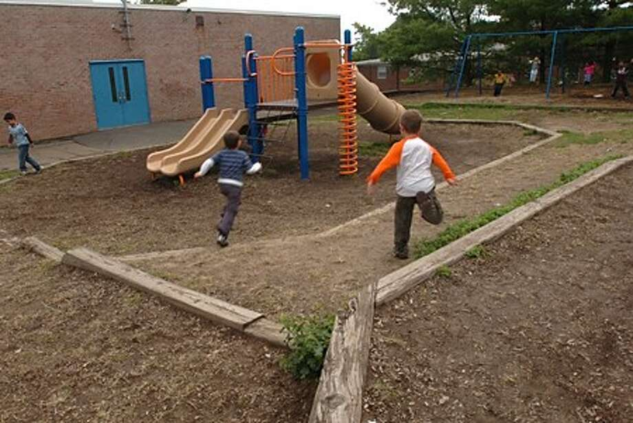The playgound at Jefferson Elementary School where broken equipment and uneven surfaces pose hazards to children. Parents at Jefferson are upset at the fact that while other schools are recieving new playgrounds their school is not. Hour photo / Erik Trautmann