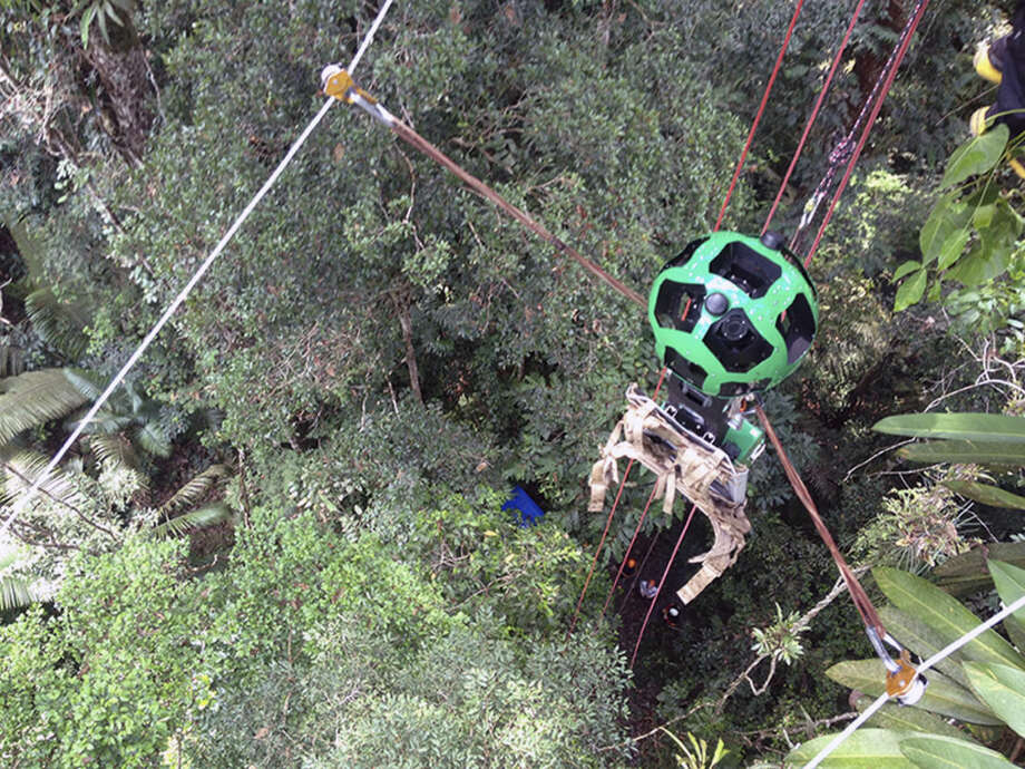 This undated image released by Google on Monday, March 2, 2015 shows the company's Trekker device on a zipline above the Amazon jungle in South America. The images taken by the Trekker are the latest addition to the diverse collection of photos supplementing Google's widely used digital maps. (AP Photo/Google)