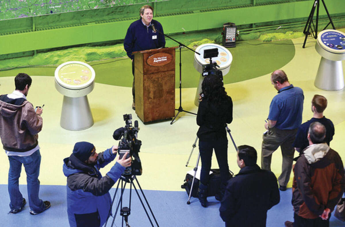 Hour photo / Erik Trautmann Tom Naiman, Director of Education, The Maritime Aquarium speaks at a press conference announcing a new free summer program at The Maritime Aquarium for 7th- and 8th-graders in Norwalk Public Schools that is funded by the Norwalk Energy Efficiency Challenge.