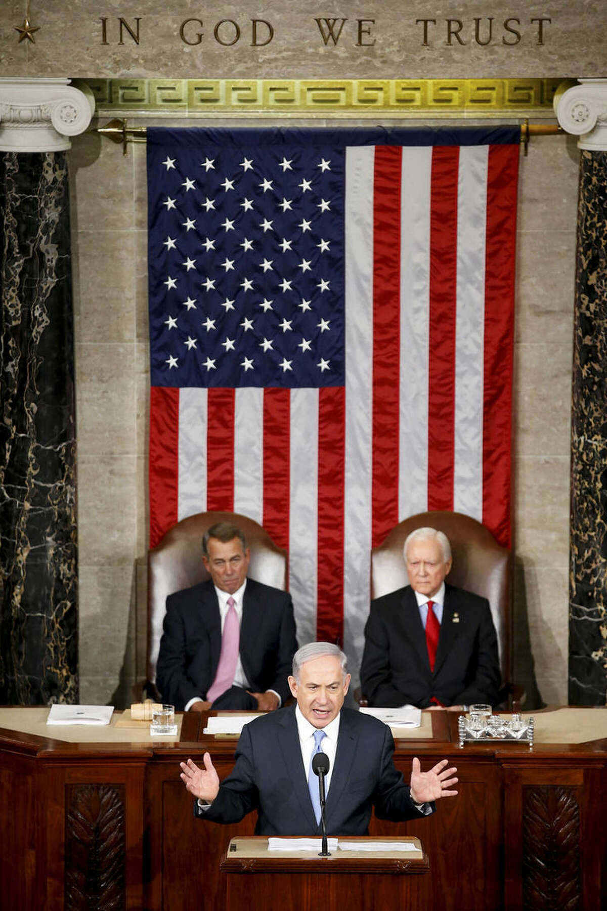 Israeli Prime Minister Benjamin Netanyahu speaks before a joint meeting of Congress on Capitol Hill in Washington, Tuesday, March 3, 2015. Netanyahu is using the address to warn against trusting Iran to curb its nuclear ambitions. House Speaker John Boehner of Ohio, left, and Sen. Orrin Hatch, R-Utah, listen. (AP Photo/Andrew Harnik)
