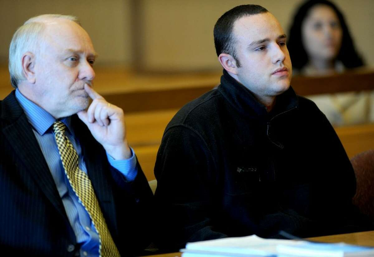 Aaron Ramsey of Wilton, right, sits beside his lawyer, Howard Ehring, left, as Ramsey is found not guilty by reason of mental disease or deficiency by a three-judge panel during a verdict reading at state Superior Court in Stamford on Wednesday, December 12, 2012. Ramsey was on trial for beating his father, Edward, to death in May after Ramsey allegedly heard voices.