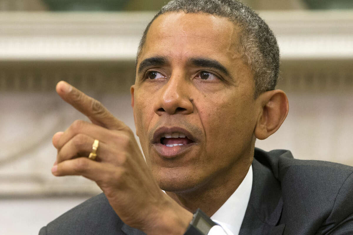 President Barack Obama speaks about Iran and Israeli Prime Minister Benjamin Netanyahu's speech to Congress, Tuesday, March 3, 2015, during a meeting with Defense Secretary Ash Carter in the Oval Office of the White House in Washington. (AP Photo/Jacquelyn Martin)