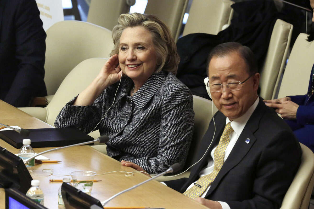 Hillary Rodham Clinton and U.N. Secretary General Ban Ki-moon listen to speeches in the ECOSOC chamber of the United Nations, during the annual Women's Empowerment Principles event, Tuesday, March 10, 2015. (AP Photo/Richard Drew)