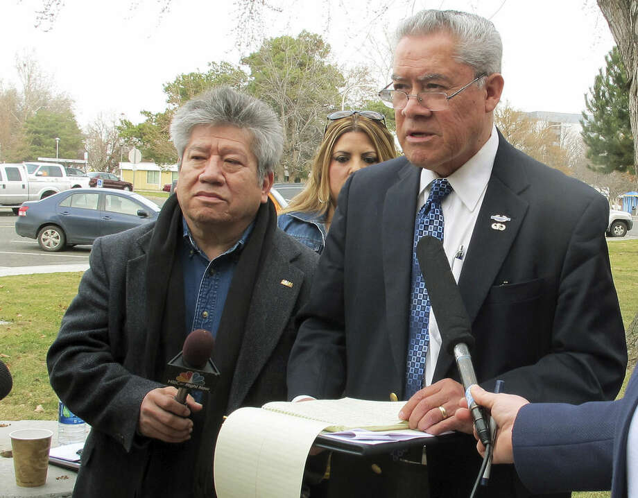 FILE - In this Feb. 25, 2015 file photo, activist Felix Vargas, right, talks with reporters in Kennewick, Wash., after a briefing on the investigation of the fatal police shooting of Antonio Zambrano-Montes, who was unarmed, in nearby Pasco, Wash., on Feb. 10. Vargas said he is calling for a federal investigation of the shooting. Ferguson, Mo., has become an emblem of the tensions between minorities and police departments nationwide since Darren Wilson, a white officer, shot and killed Michael Brown, an unarmed black teenager, last summer. A U.S. Justice Department report released the first week of March, 2015, cleared Wilson of criminal wrongdoing. Though the study centered on Ferguson, its findings have resonated nationwide as residents in some communities across the country say they feel they face the same struggles with their police departments and city leadership.(AP Photo/Nicholas K. Geranios, File)