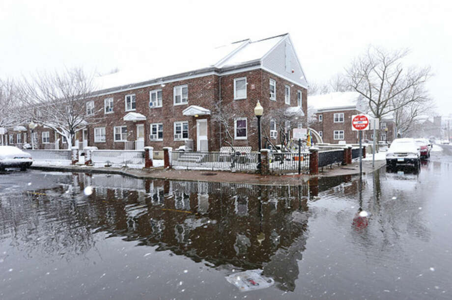 Snowstorm Saturn which blew back over Norwalk after going out into the Atlantic left 3 inhces of snow on the ground and flooding on water St near Washington Village. Hour photo / Erik Trautmann