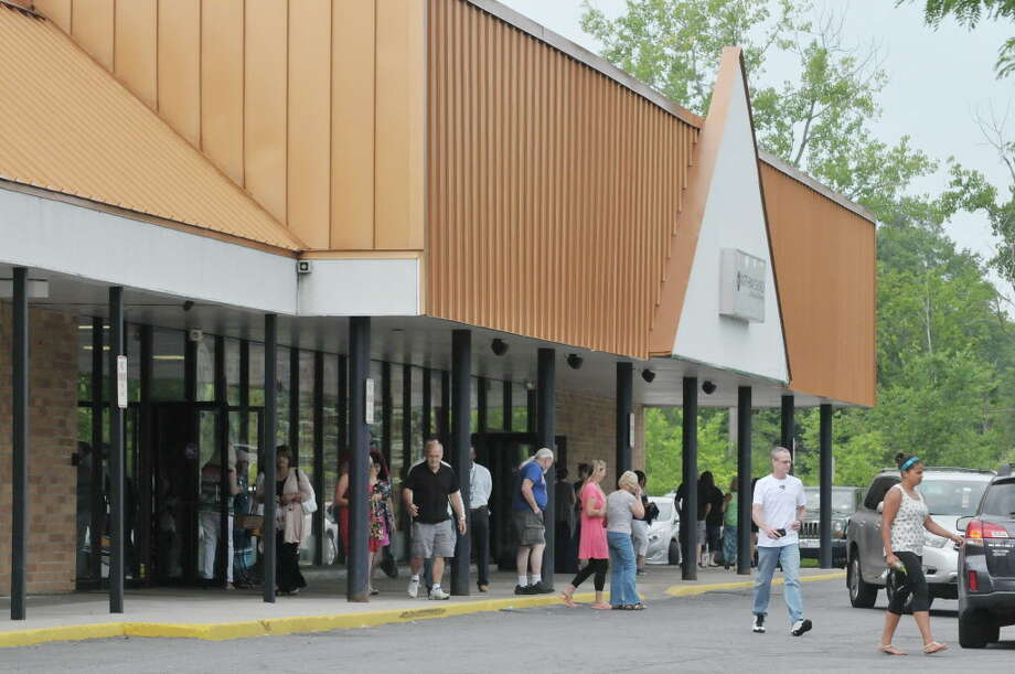 People make their way out of the  Northway Church following a service on Sunday morning, July 19, 2015, in Clifton Park, N.Y.      (Paul Buckowski / Times Union) Photo: PAUL BUCKOWSKI / 00032655A
