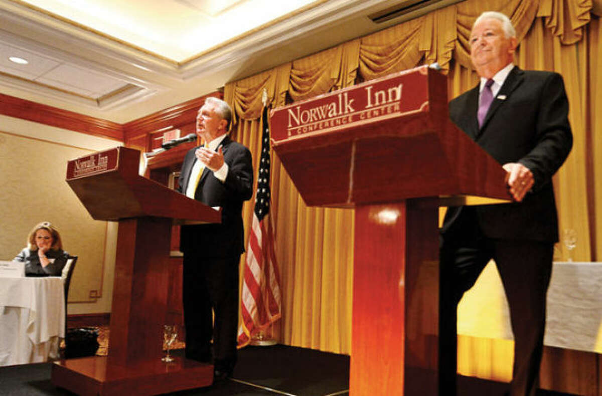 Hour photo / Erik Trautmann Mayor Harry Rilling and former Mayor Richard Moccia debate at the Norwalk Inn and Conference Center during last year's election.