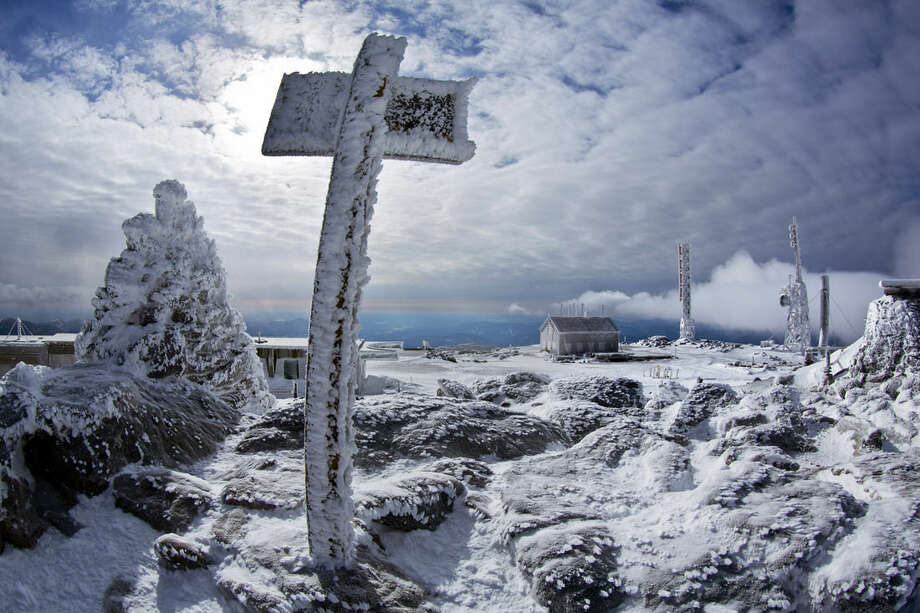 In this Tuesday, March 10, 2015 photo, a sign marks the summit of 6,288-foot Mount Washington, New Hampshire. (AP Photo/Robert F. Bukaty)