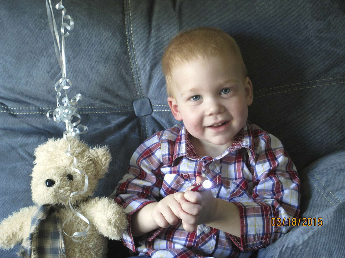 In this March 18, 2015 photo provided by Rose Martin, 22-month-old Gardell Martin sits at his home in Mifflinburg, Pa. Gardell's lifeless body pulled from an icy creek was revived after an hour and 41 minutes of CPR and has suffered virtually no lingering effects. Martin came home from the hospital on Sunday, and his doctors said Thursday he has made a full recovery. (AP Photo/Rose Martin)