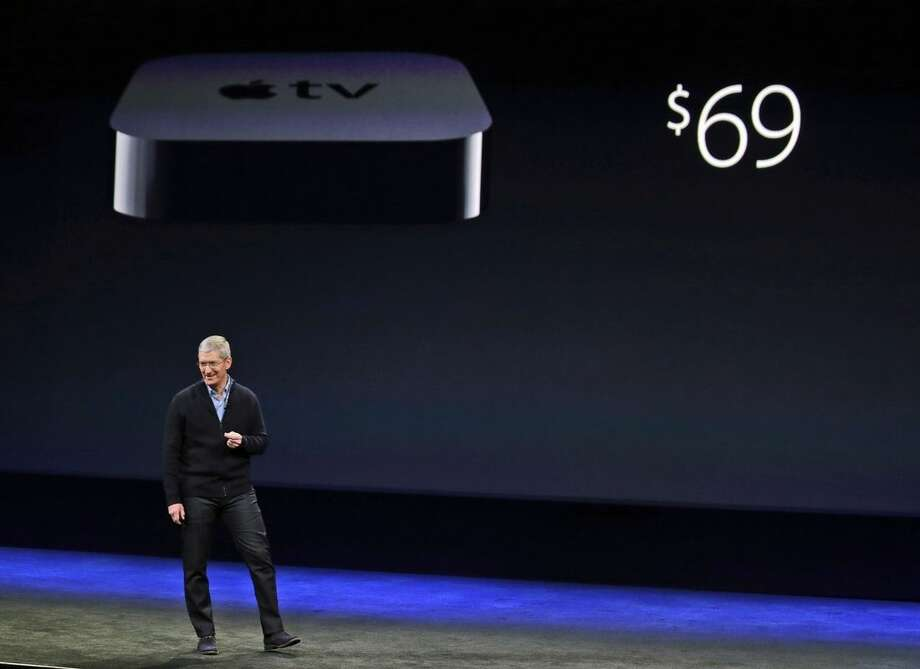 Apple CEO Tim Cook talks about Apple TV's new lower price during an Apple event on Monday, March 9, 2015, in San Francisco. (AP Photo/Eric Risberg)