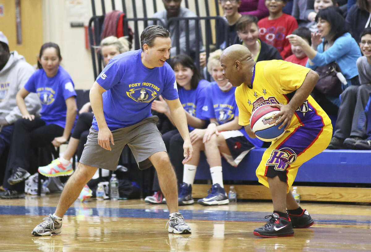 State Sen. Bob Duff plays for the Foxy Trotters during a basketball game against the Harlem Wizards at Brien McMahon High School Sunday afternoon. Hour photo/Danielle Calloway