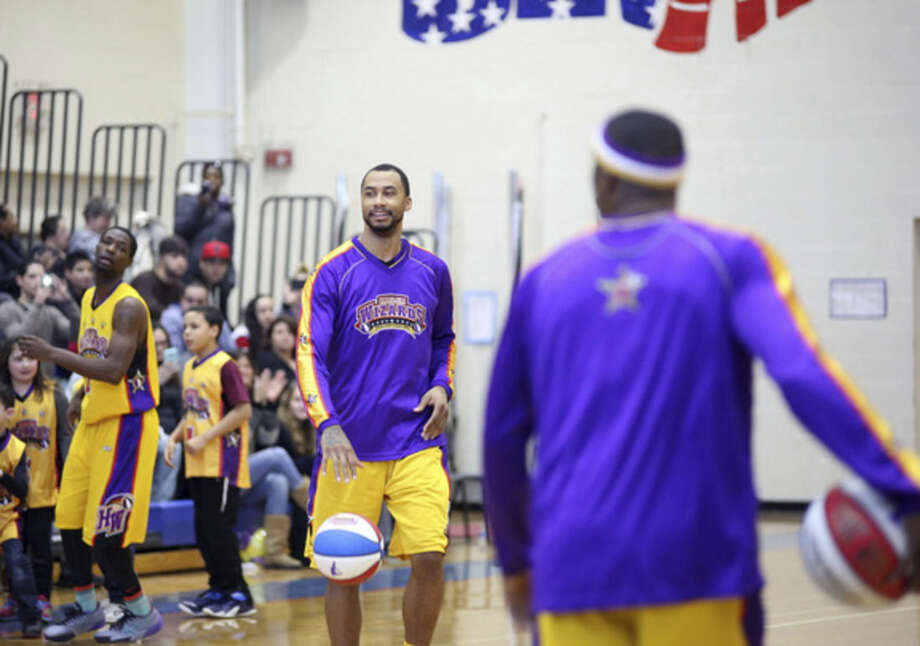 The Harlem Wizards are introduced before a game against the Foxy Trotters at Brien McMahon High School Sunday afternoon.Hour photo/Danielle Calloway