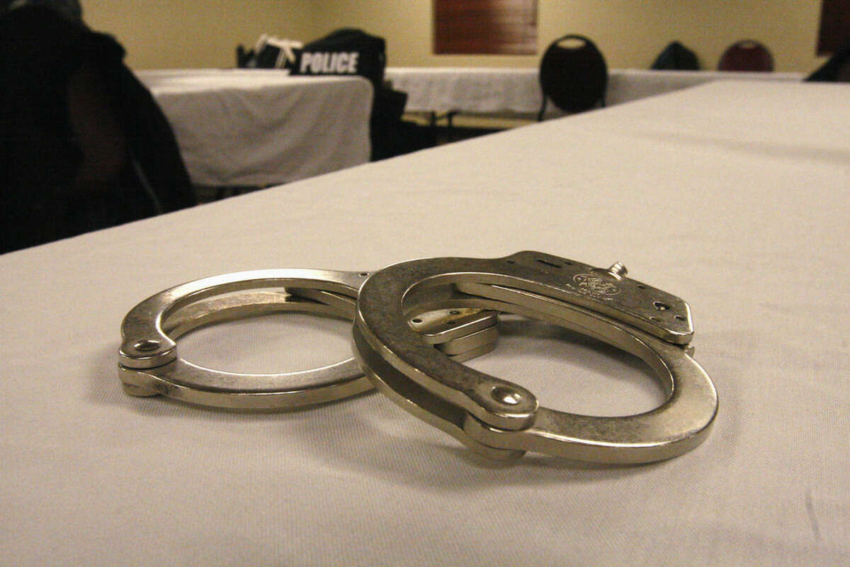 ADVANCE FOR USE MONDAY, MARCH 9, 2014 AND THEREAFTER - Handcuffs used on men arrested for prostitution solicitation sit on a table at a hotel in Minot, N.D., on Saturday, Jan. 31, 2015. Sex trafficking has become a big problem in North Dakota amid an oil boom that has brought in money and oil workers. The Minot police sting ended with the arrests of 13 men, who answered ads on an escort website posted by the undercover officers. (AP Photo/Martha Irvine)