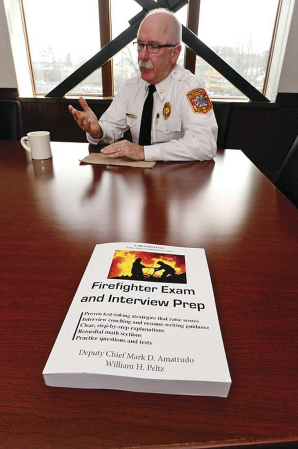 Hour photo / Erik Trautmann Norwalk Fire Chief Denis McCarthy talks about preparing for the firefighter admission test.