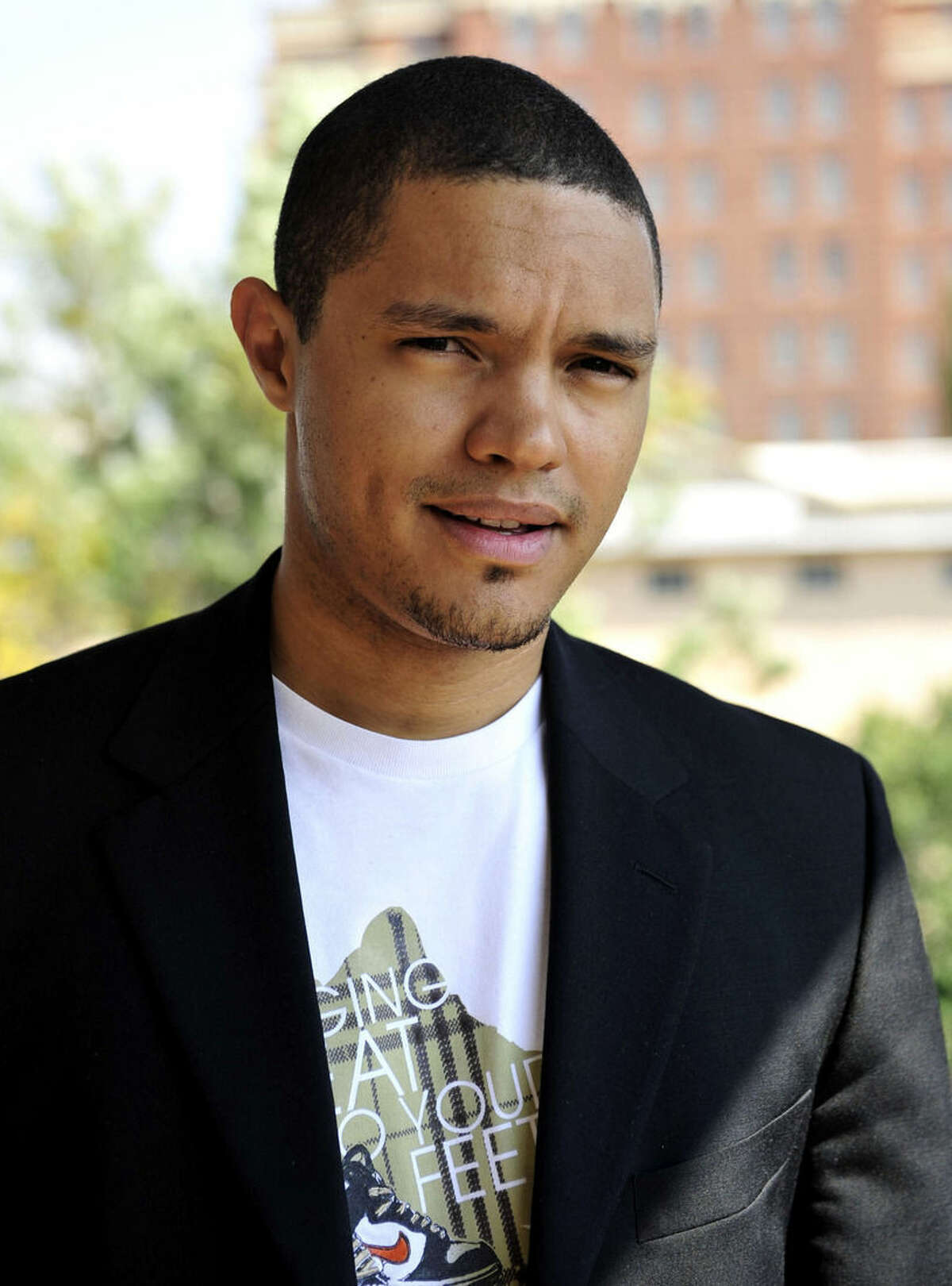 """In this photo taken Oct. 27 2009 South African comedian Trevor Noah is photographed during an interview. Trevor Noah, a 31-year-old comedian from South Africa who has contributed to """"The Daily Show"""" a handful of times during the past year, will become Jon Stewart's replacement as host, Comedy Central announced Monday March 30, 2015. Noah was chosen a little more than a month after Stewart unexpectedly announced he was leaving """"The Daily Show"""" following 16 years as the show's principal voice. (AP Photo/Bongiwe Mchunu-The Star) SOUTH AFRICA OUT NO SALES NO ARCHIVE"""