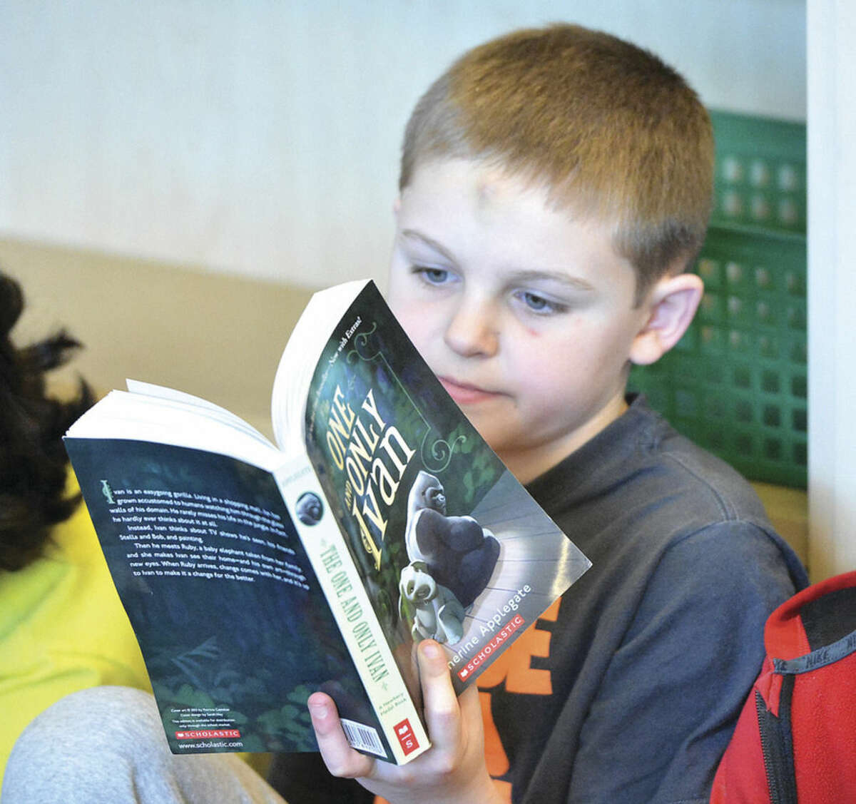 Hour Photo/Alex von Kleydorff Andrew Mcnamara reads along in class as all the students will read The One and only Ivan part of the reading program One book for Brookside.