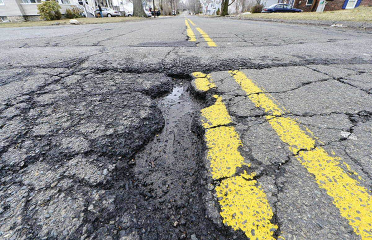 Hour photo/Erik Trautmann Norwalk's public works department releases its 2015 summer road-paving program list of streets. Walter Avenue is slated for repaving and installation of a sidewalk on the west side. There is no sidewalk now and schoolchildren must walk in the street.