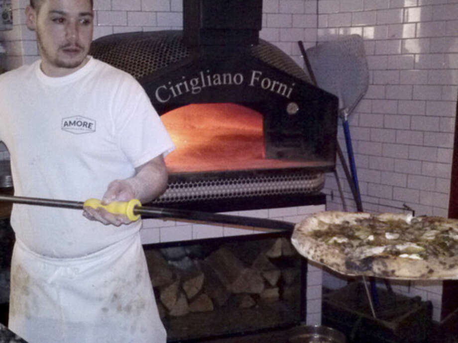Photo by Frank WhitmanPizza from the 900-degree oven at Amore.