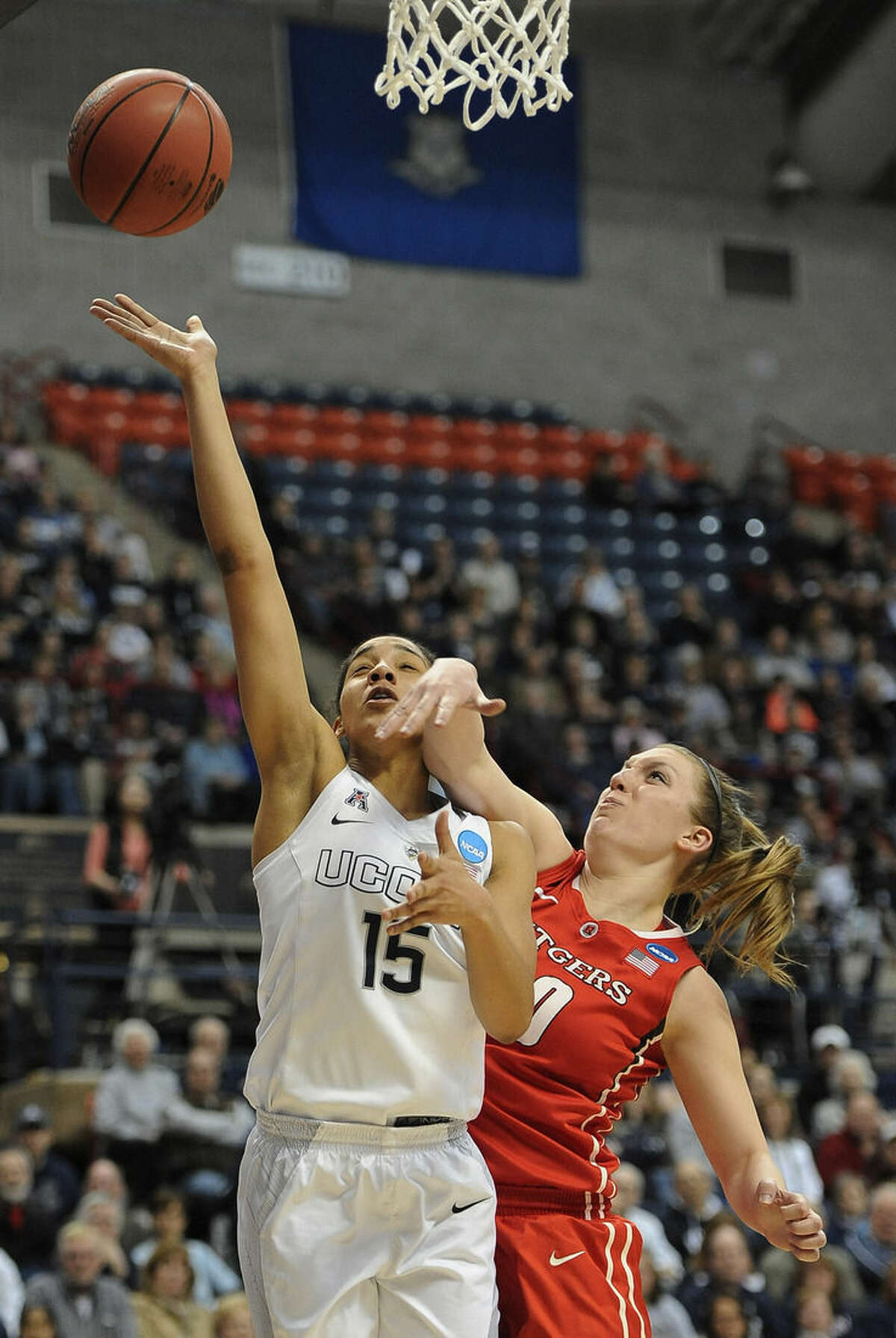 Connecticut's Gabby Williams, left, shoots as Rutgers' Christa Evans, right, defends during the first half of a college basketball game in the second round of the NCAA tournament Monday, March 23, 2015, in Storrs, Conn. (AP Photo/Jessica Hill)