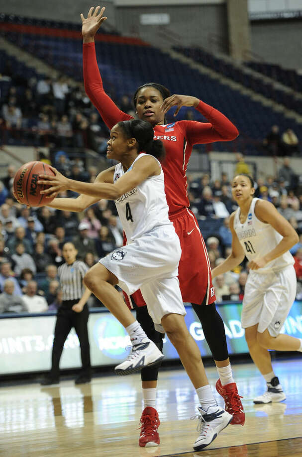 Connecticut's Moriah Jefferson, left, shoots past Rutgers' Rachel Hollivay during the first half of a women's college basketball game in the second round of the NCAA tournament, Monday, March 23, 2015, in Storrs, Conn. UConn won 91-55.(AP Photo/Jessica Hill)