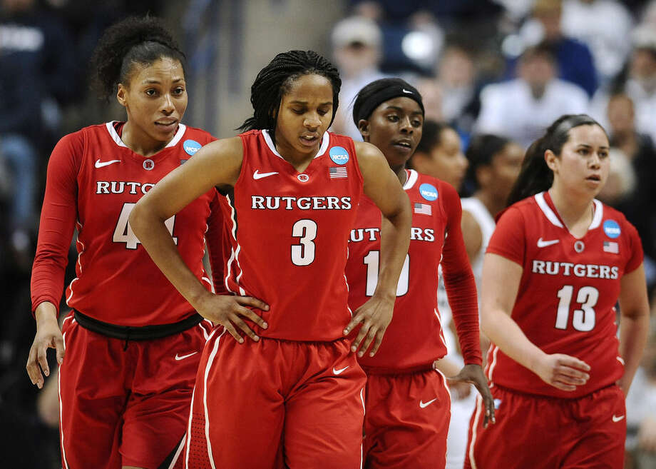 Rutgers' Betnijah Laney (44), Tyler Scaife (3), Shrita Parker (10), and Cynthia Hernandez walk off the court during the first half of a women's college basketball game against Connecticut in the second round of the NCAA tournament, Monday, March 23, 2015, in Storrs, Conn. (AP Photo/Jessica Hill)