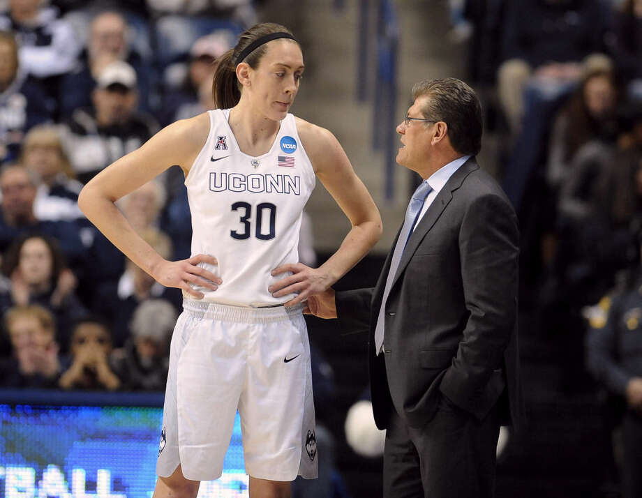 Connecticut's Breanna Stewart, left, talks with Connecticut head coach Geno Auriemma during the first half of a women's college basketball game against Rutgers in the second round of the NCAA tournament, Monday, March 23, 2015, in Storrs, Conn. (AP Photo/Jessica Hill)