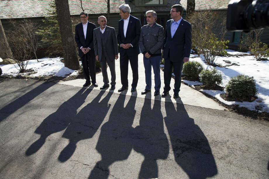 Secretary of State John Kerry, center, speaks before the start of meetings at the Camp David Presidential retreat, Monday, March 23, 2015, in Camp David, Md. The pace of U.S. troop withdrawals from Afghanistan will headline Afghan President Ashraf Ghani's visit to Washington, yet America's exit from the war remains tightly hinged to the abilities of the Afghan forces that face a tough fight against insurgents this spring. From left are, Treasury Secretary Jacob Lew, Afghanistan's President Ashraf Ghani, Kerry, Afghanistan's Chief Executive Abdullah Abdullah, and Defense Secretary Ash Carter. (AP Photo/ Evan Vucci)